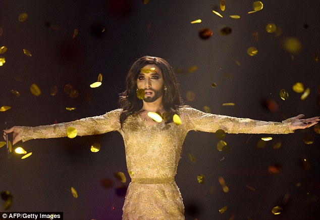 Overwhelmed: Conchita looked emotional as she performed her winning song Rise Like A Phoenix