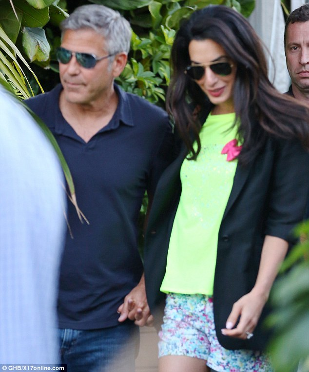 Congrats! George Clooney and his fiancee Amal Alamuddin celebrated their engagement at Cindy Crawford's restaurant Cafe Habana Malibu in Malibu, California on Sunday