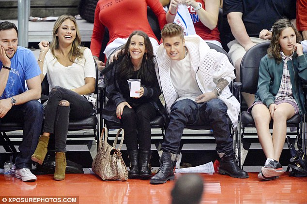 Fun times: They shared a good laugh as Bieber placed an arm around his mother