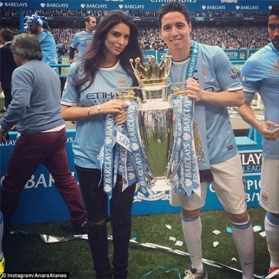 Delighted: Atanes and Nasri pose with the Premier League title after City's win against West Ham on Sunday