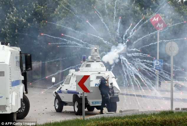 Police fired tear gas and water cannon as demonstrators hurled fireworks, shouting anti-government chants