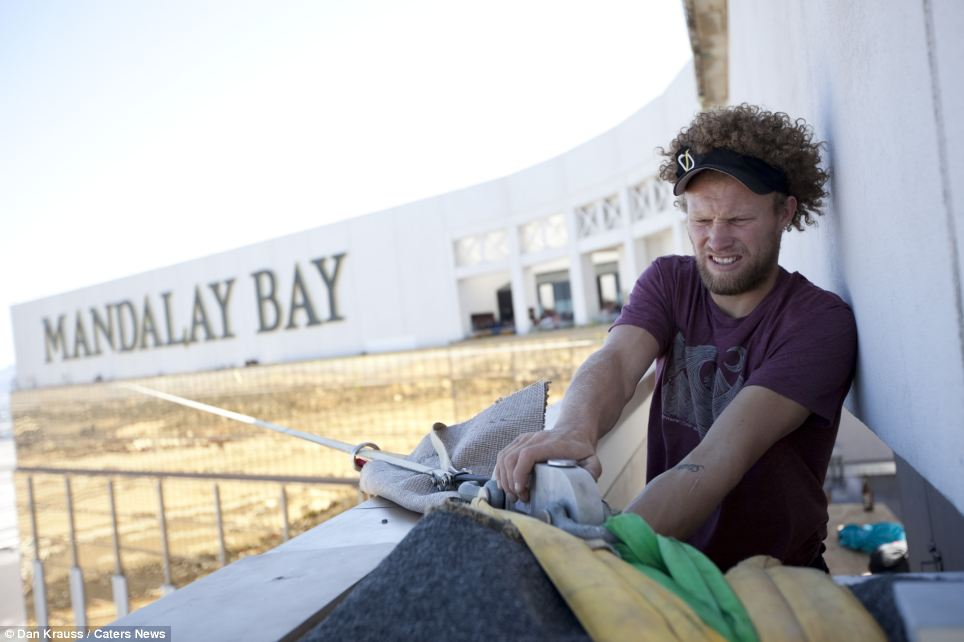 Slackline world record holder Andy Lewis carries out safety checks on the slackline which was installed between two 63rd floor towers of the luxury Mandalay Bay Hotel in Las Vegas