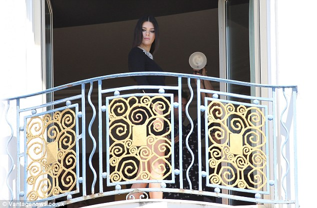 Peekaboo: The brunette beauty was snapped wearing a thigh-skimming LBD while lights were adjusted around her