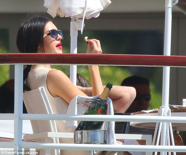 Laid-back lovely: Kendall didn't look to have a care in the world as she made the most of the sunshine