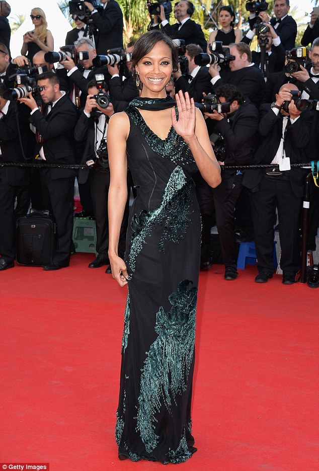 Lean in green: Zoe Saldana looked lovely in a full-length green and black gown