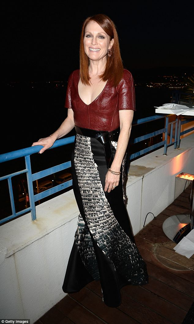 From day to evening: Julianne Moore attends the L'Oreal & Unifrance Films 65th Anniversary Cocktaill at Hotel Martinez in her musical-print gown
