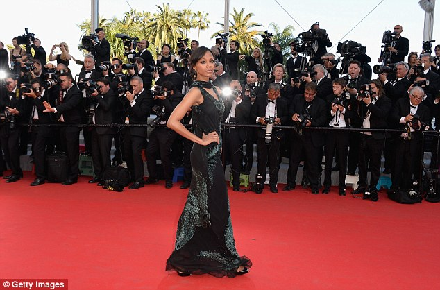 Star power: Zoe was photographed by throngs of photographs as she posed on the red carpet