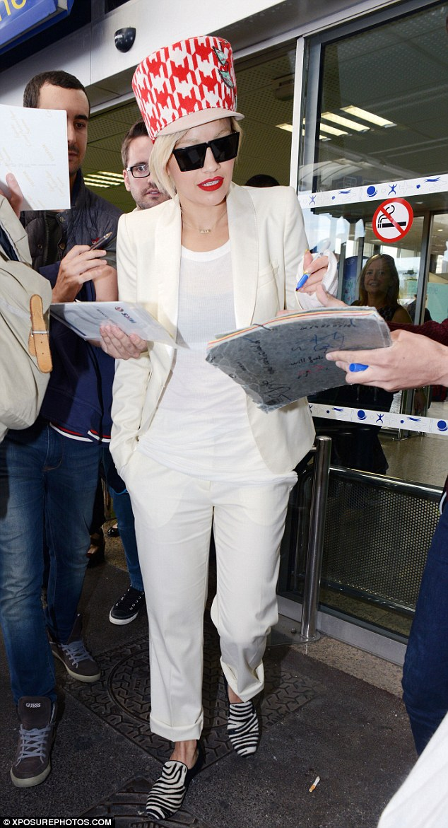 Voulez-vous? Rita is swamped by autograph-hunting French fans