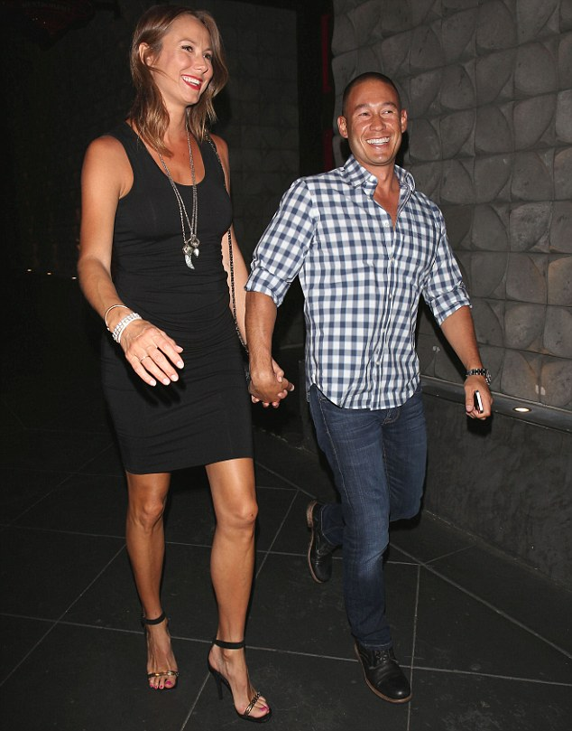 Walking tall: The pregnant  actress and former professional wrestler showed off her tanned and never-ending legs in a sexy LBD