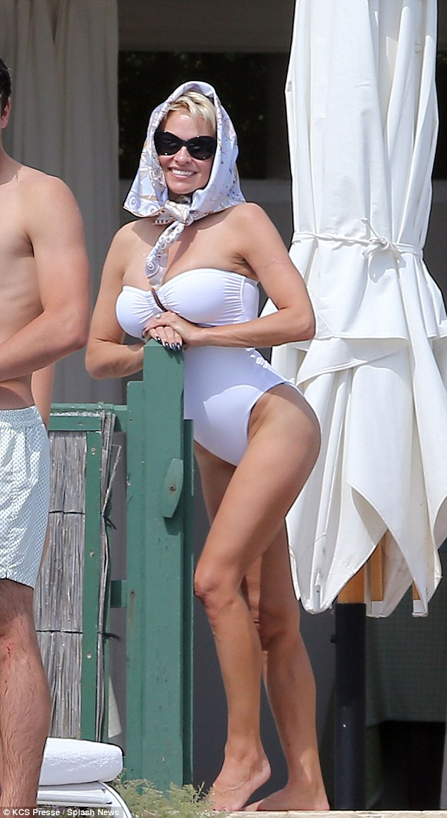 Pure glamour: Pamela Anderson rocks a white bikini looking very screen siren indeed at the Eden Roc Hotel during the 67th Cannes Film Festival in France on Friday