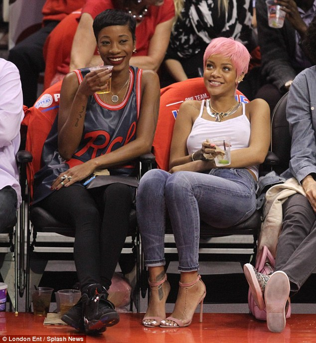 Good times: Rihanna took in the game with close pal Melissa Forde