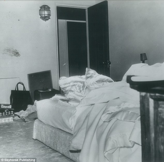 Mystery: This police photo, exclusively obtained by the authors, reveals a possible blood smudge on the wall of Marilyn's  bedroom. This smudge was subsequently airbrushed out of the photo released to the public