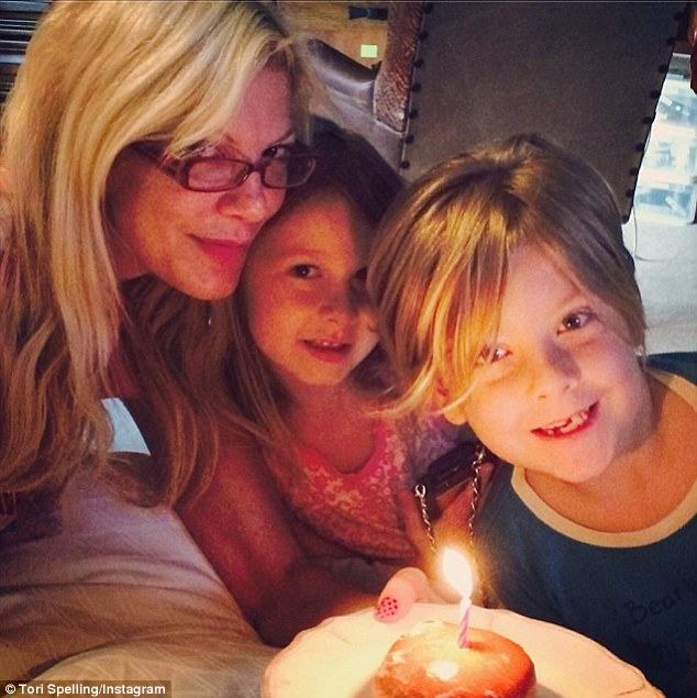'A birthday donut from my babes...#happymama!' The super-slim reality star was sweetly presented with a candle-lit jelly donut by her seven-year-old son Liam and daughter Stella, who turns six next month