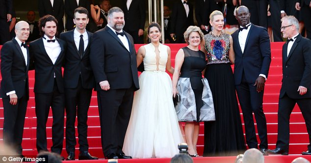 Brave face: America tried to laugh off the incident and gamely posed for pictures with her co-stars including Kit Harrington (second left) and Cate Blanchett (third from right)