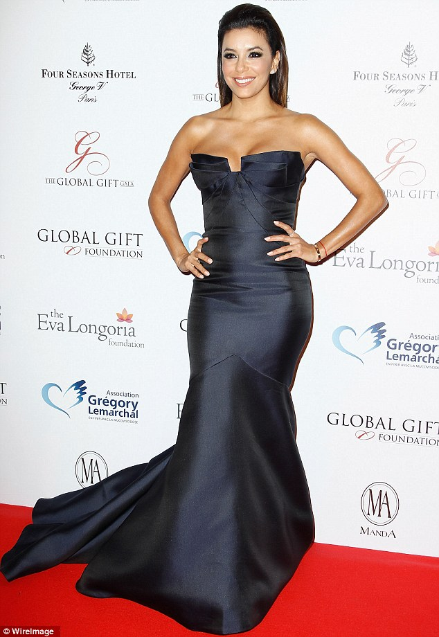 Beautiful in blue: Eva also hosted a Global Gift Gala in Paris on Monday, looking regal in a midnight blue gown