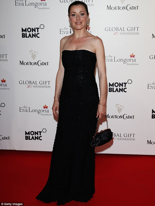 Classic: Australian singer and actress Tina Arena donned a glitzy strapless black gown to the gala