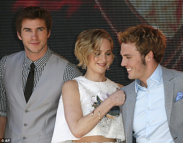 Playful punch: Jennifer was on form after taking to the stage with Liam and Sam
