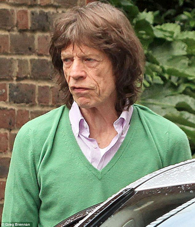 Looking drawn: Sir Mick Jagger looked tired when he was spotted out and about in London
