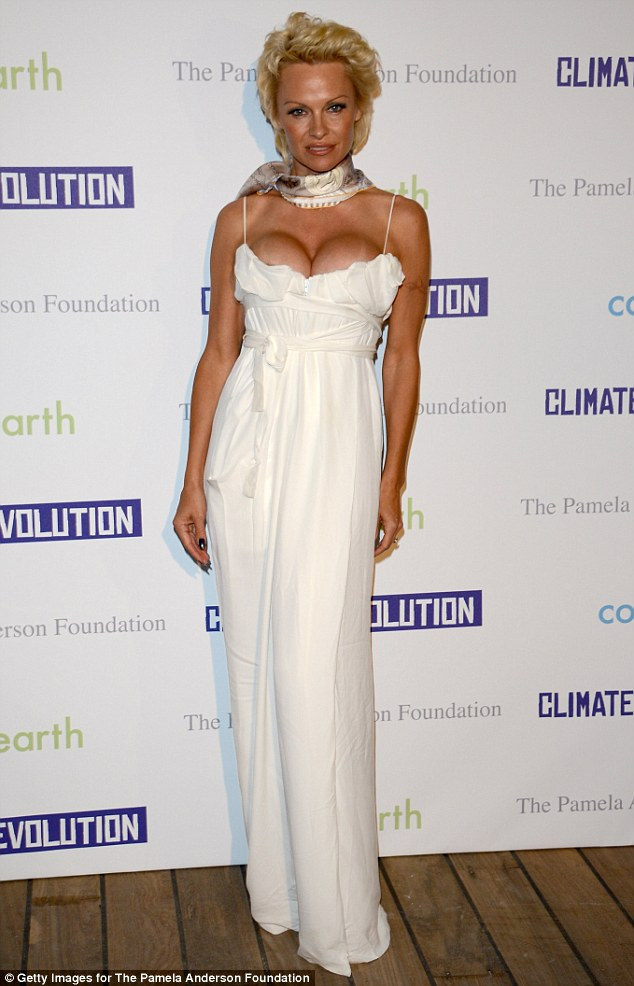 Big night: Pamela Anderson opted for a white Vivienne Westwood frock at the launch of her The Pamela Anderson Foundation charity in Cannes, France on Friday