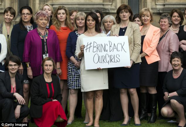 Support: Cross party MP's gather outside the Houses of Parliament for a photo call to show their support for the #bringbackourgirls campaign