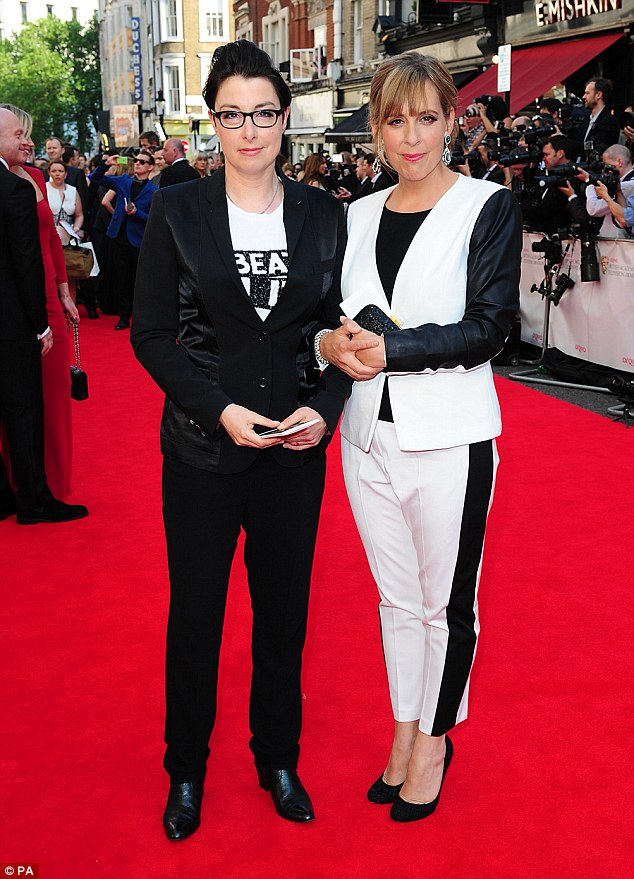 If in doubt, wear the inside-out version of your guest's outfit: Sue Perkins (left) and Mel Giedroyc arriving for the BAFTAs