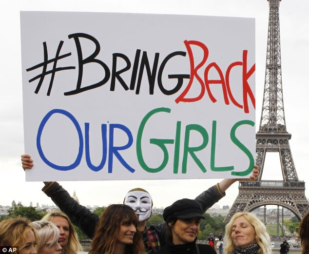 Group: Another rally in support of the #bringbackourgirls campaign in front of the Eiffel Tower