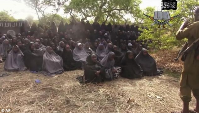 Chilling: Another terrifying still from a video by Nigeria's Boko Haram terrorist network which shows the missing girls
