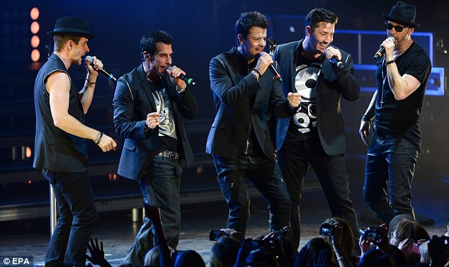 Feeling the rhythm: With the microphones close to their lips, the group were completely wrapped up in the moment