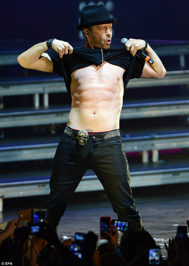 Still got it! Donnie Wahlberg lifted up his shirt and revealed his chiseled abs in the middle of a performance in Frankfurt, Germany on Saturday