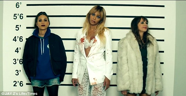Bad girls club: The law catches up with the 32-year-old who stands in a line-up wearing just a bra, a pair of crocheted pants and a white jacket which are all covered in blood, along with sisters Rashia and Kidada Jones