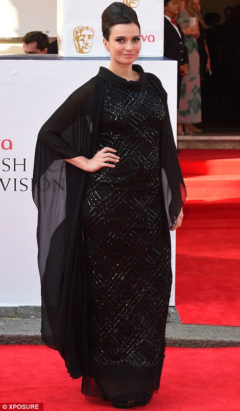 Gizzie Erskine wears retro black and sequinned criss-cross dress
