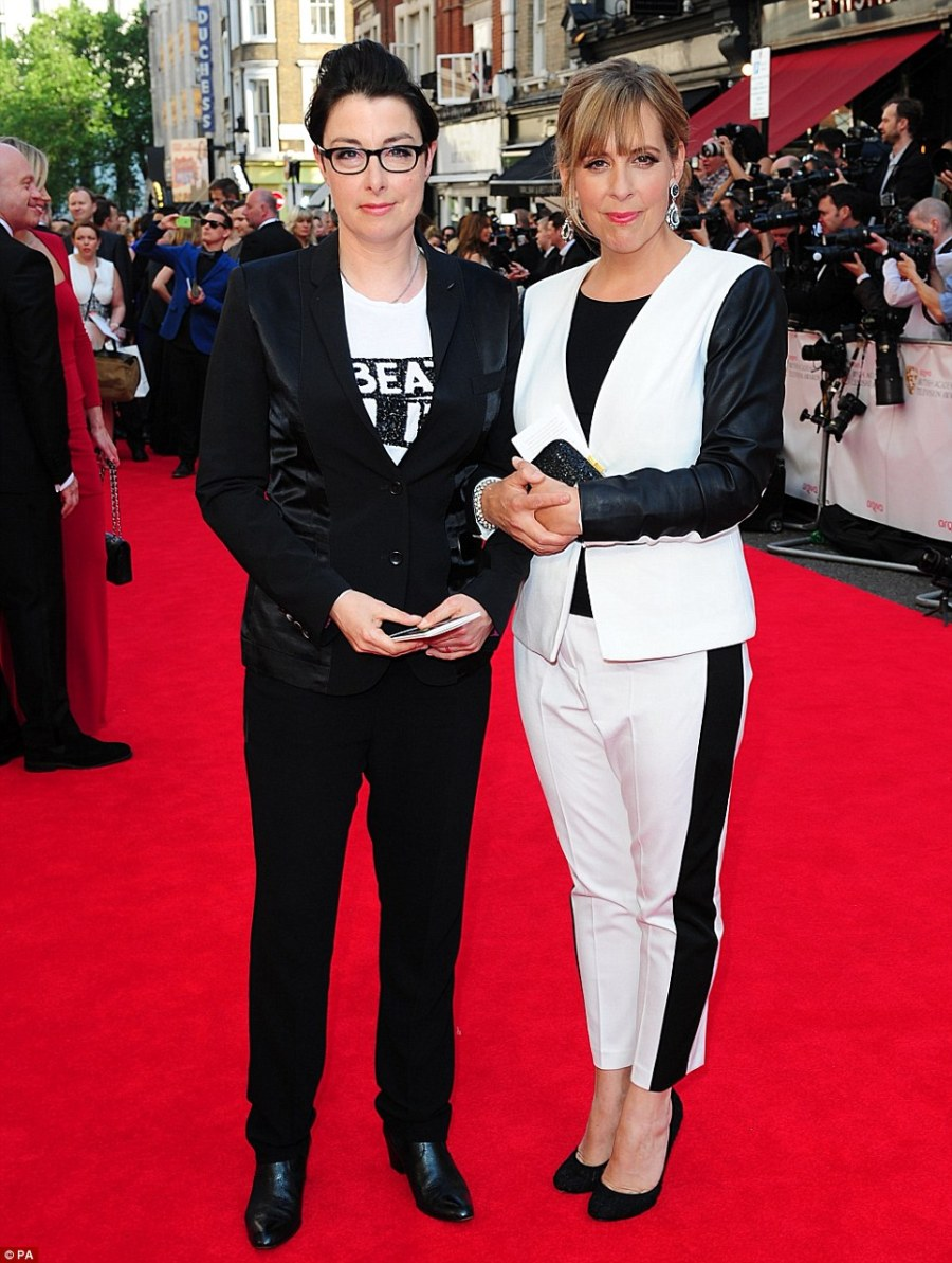 Black and white: The Great British Bake Off presenters Sue Perkins (left) and Mel Giedroyc attend in monochrome suits