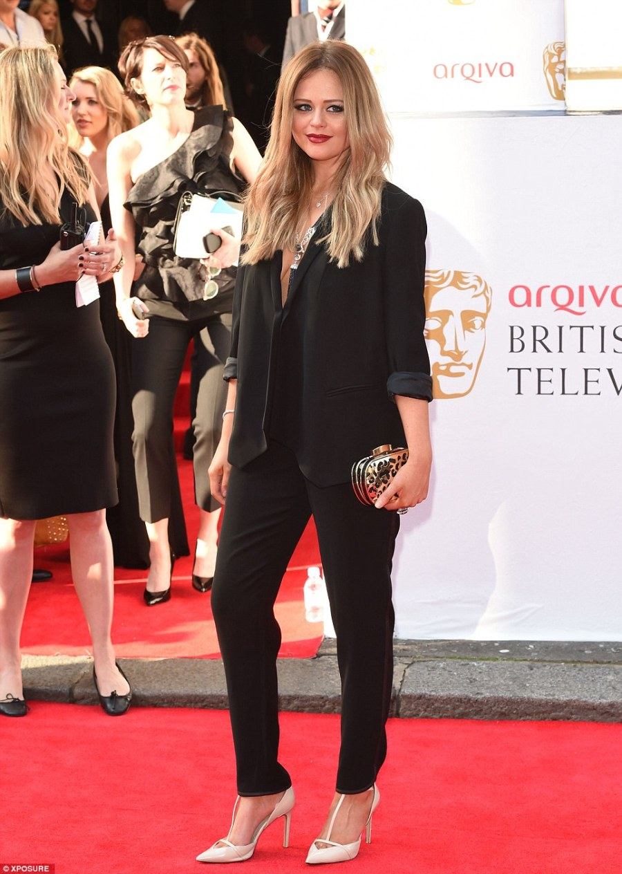 Masculine: Emily Atack bucked the trend by wearing a smart trouser suit.. but it was still in gothic black. The actress also wore Beauty Works Celebrity Choice Keratin Bonds shade #6/24 Honey Blonde