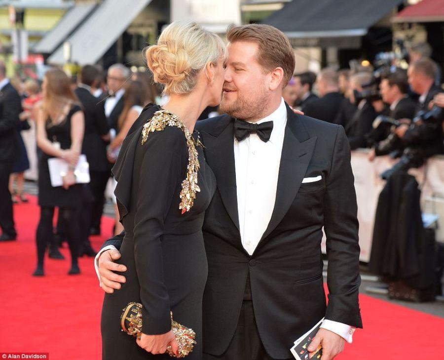 Romance: James Corden can't resist giving his wife Julia Carey a kiss