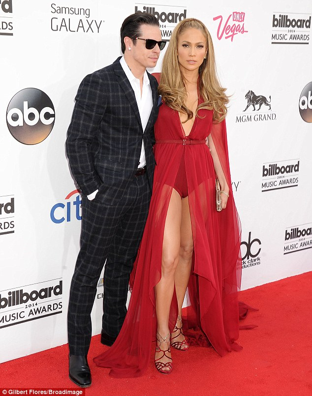 Making a statement: The singer wowed on the red carpet at Sunday's Billboard Music Awards in Vegas, pictured with boyfriend Casper Smart