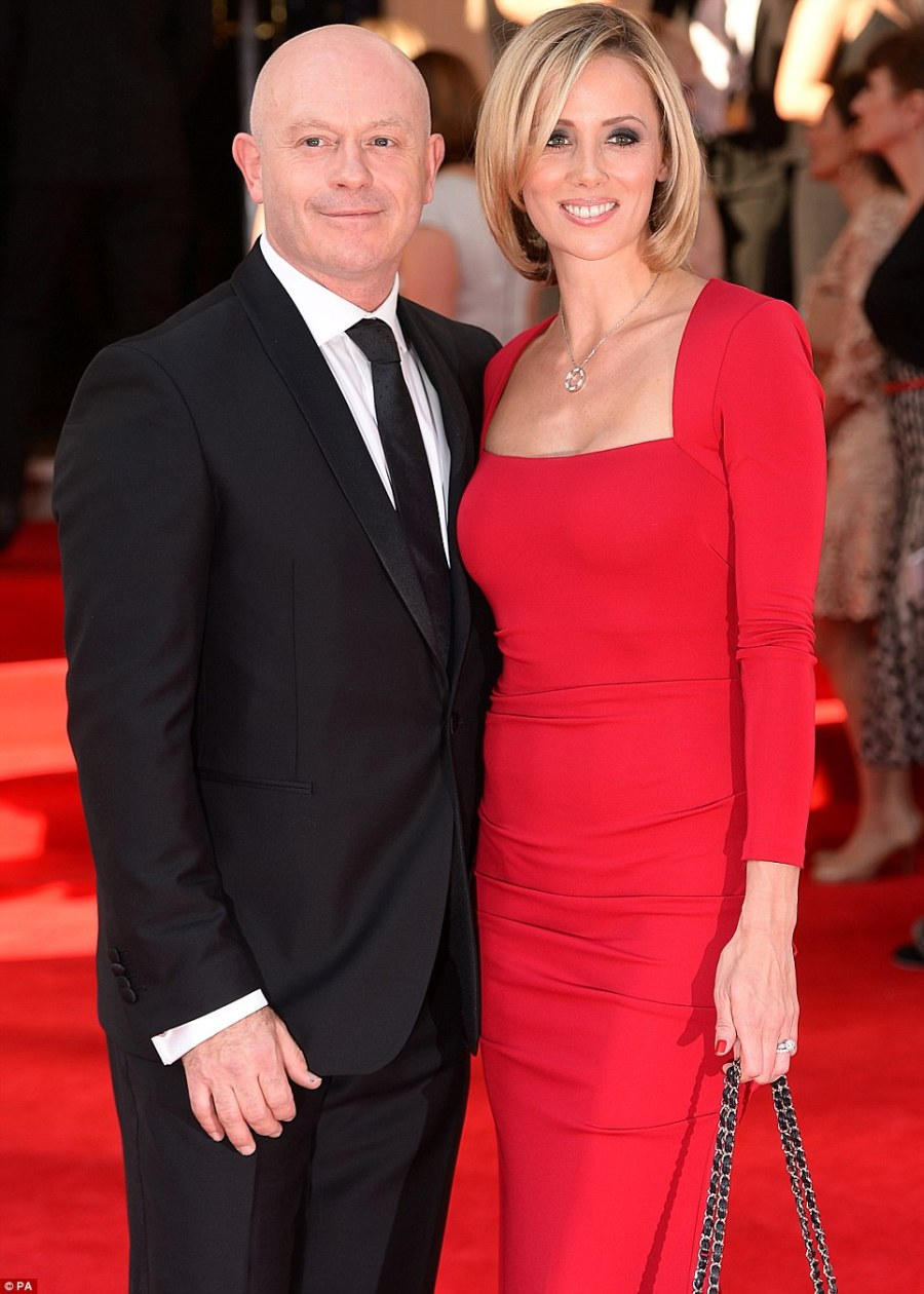 Blending in: Ross Kemp looked dapper in black as he posed with his wife Renee O'Brien, who wowed in a long-sleeved red dress