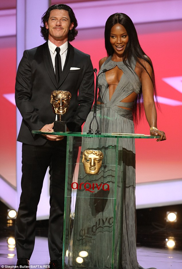 Stealing focus: Luke Evans and Naomi Campbell looked gorgeous as they presented the Best Feature award