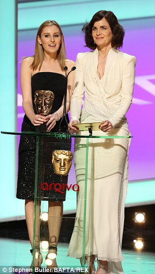 Quite a pair: Downton Abbey's Laura Carmichael and Elizabeth McGovern present an award on Sunday evening