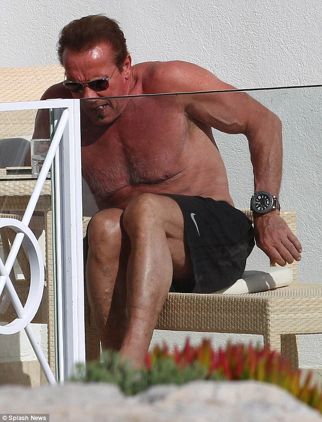 A little R&R: The former body builder appeared to be relaxed while preparing to sunbathe
