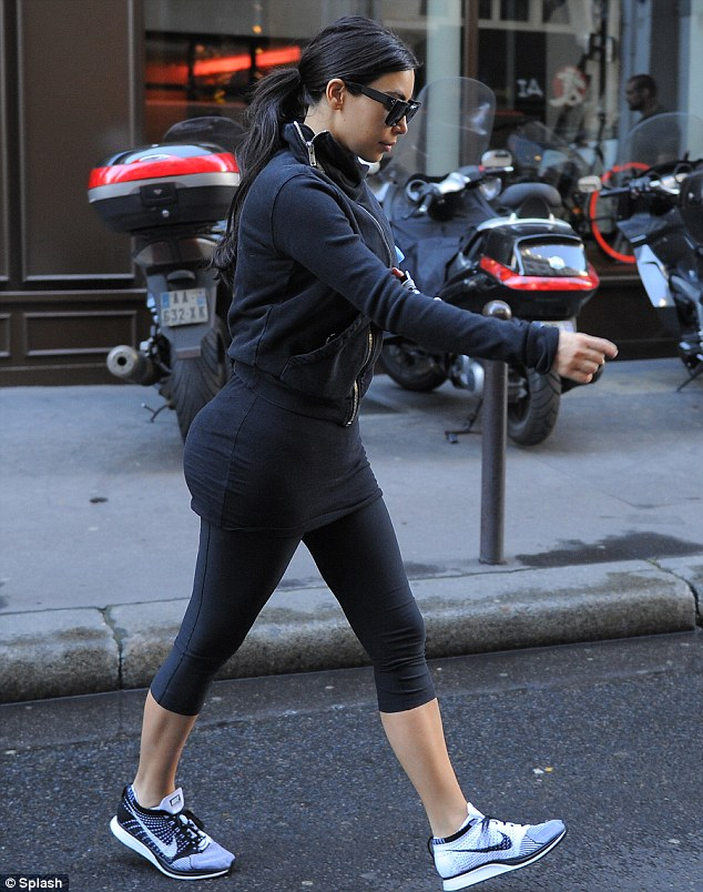 On the march: Kim looked focused as she scurried towards the gym