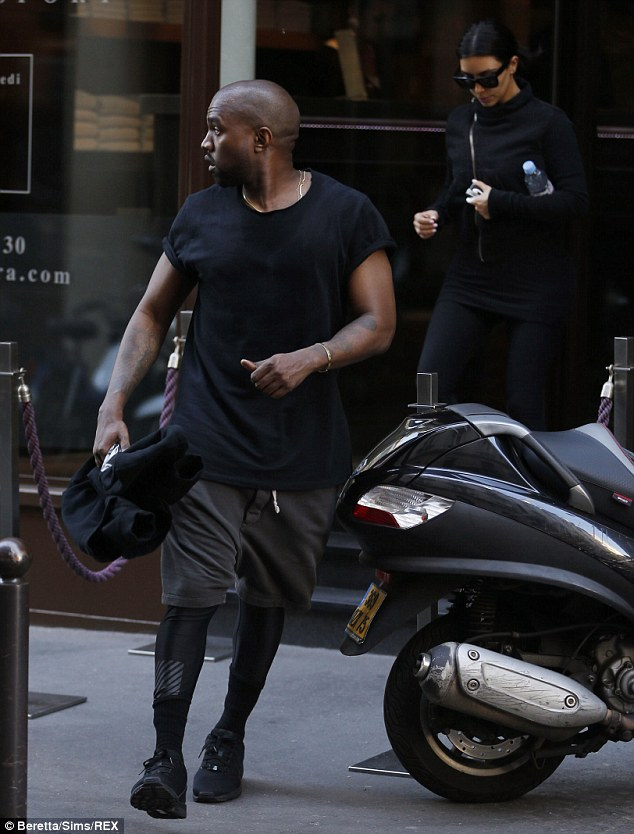 Let's go: Kim amd Kanye make their way to the gym days before their wedding - but it will NOT take place in Versailles, as originally thought