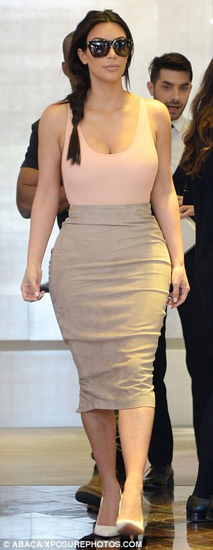 Pink to make the boys wink: Mrs West-to-be added height to her diminutive frame with a pair of skyscraper white stiletto heels, and protected her eyes from the French spring sunshine with a pair of oversized shades