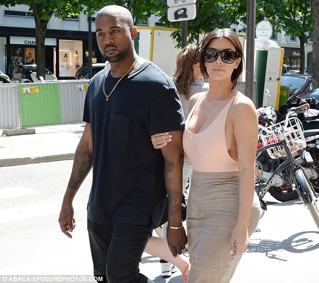 Plenty to smile about: The superstar couple seemed to be in good spirits as they went about their day, shopping at trendy concept store Colette on the upmarket Rue Saint Honore, before heading for lunch at their favourite French restaurant