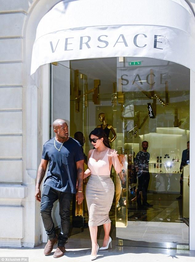 Shop till we drop: Kim and Kanye were seen visiting a number of designer shops in Paris