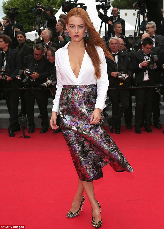 Blustery: Riley Keough was also blown about as she posed on the red carpet