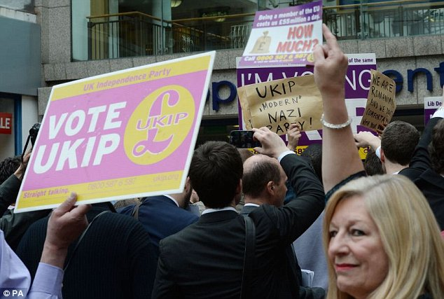 Protesters waved placards branding Ukip the 'modern Nazi party' as they disrupted the street event