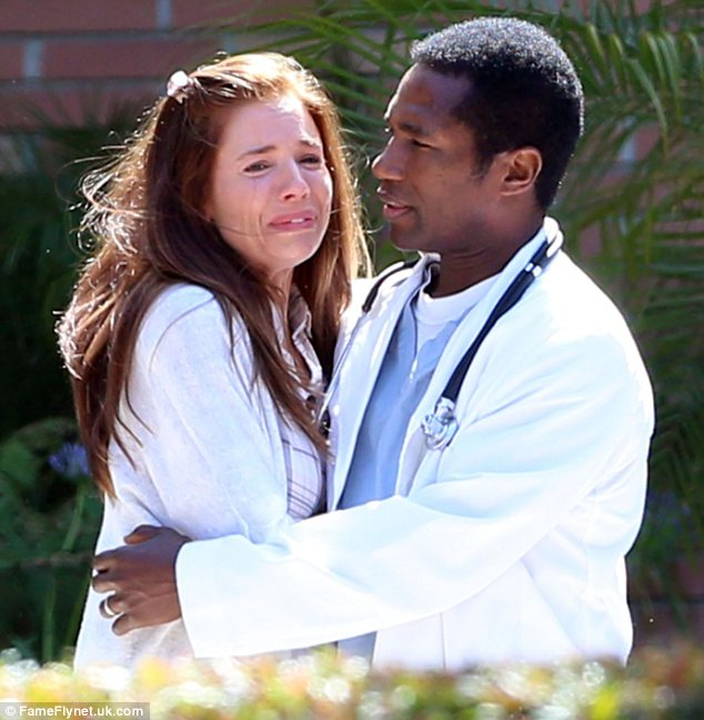 Seeking solace: A co-star dressed as a doctor in hospital scrubs wrapped Sienna in a reassuring hug