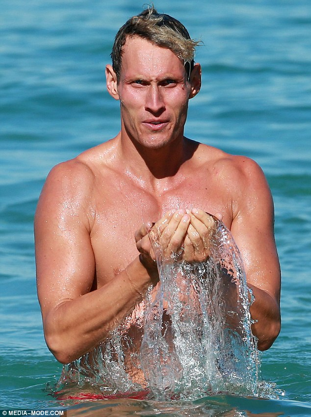 Refreshed: The hunk may train some of Hollywood's elite, but he looked like a movie star himself as he splashed water across his sizzling tanned body