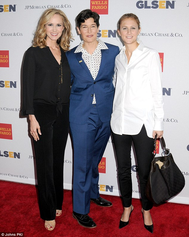 A strong turnout: Country singer Chely Wright (left) and wife Lauren Blitzer-Wright (right), whose twin sons celebrated their first birthday the previous day, were only too happy to pose for photos alongside hostest with the mostest Dr Eliza Byard