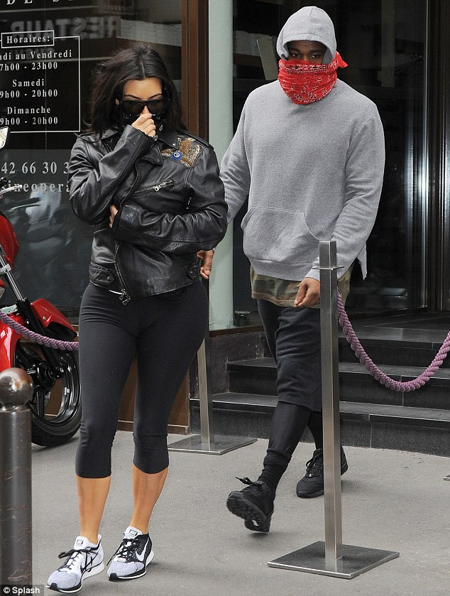Coordinated: The couple tried to go unnoticed as they made their way to Paris' L'Usine Club, sporting matching red and black bandanas